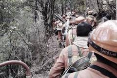 Farewell to 30 heroes fighting in SW forest fire